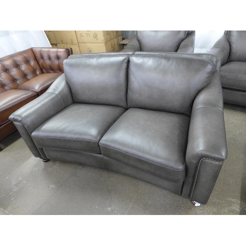 1634 - A Edinburgh two seater sofa * this lot is subject to VAT...