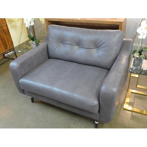 1490 - A designer grey leather love seat...