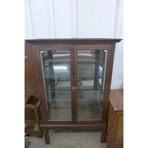 47 - An early 20th Century oak shop display cabinet, 186cms h, 119cms w, 46cms d...
