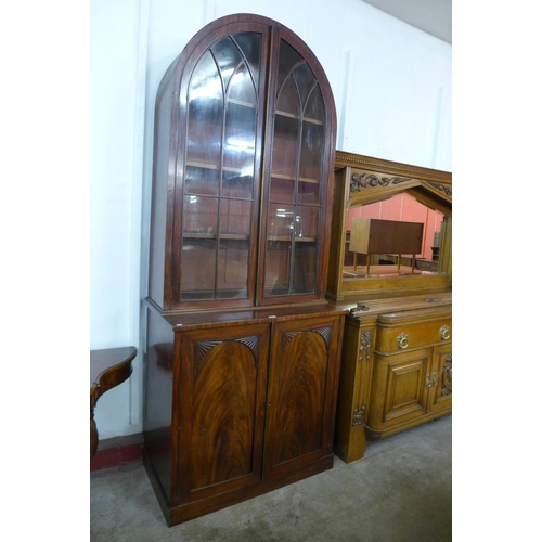 66 - A George IV mahogany dome top bookcase, 248cms h, 100cms w, 53cms d...