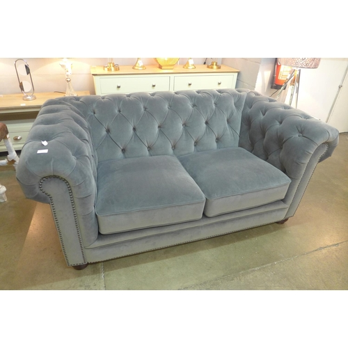 1306 - A Westerley two seater sofa * this lot is subject to VAT...