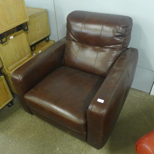 1323 - A Divani chestnut leather swivel armchair (RW211) * this lot is subject to VAT Damage scuffs to side...