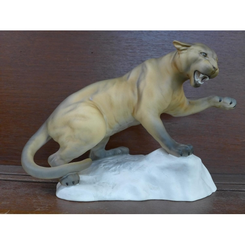 603 - A large Beswick Puma on rock, model no. 1702, second...