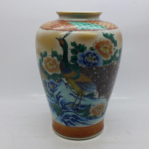607 - A Japanese vase decorated with peacocks in a garden landscape, 18cm...