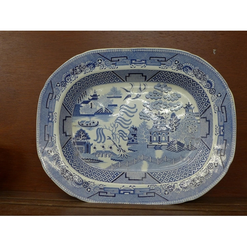 617 - A Staffordshire blue and white Willow pattern serving plate...