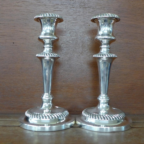 618 - A pair of silver plate on copper candlesticks by William Suckling & Son, Birmingham, 21cm...