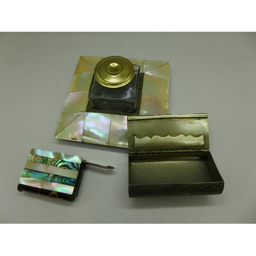624 - An inkwell, a snuff box and a vesta case, all decorated with mother of pearl, box lacking one piece ...