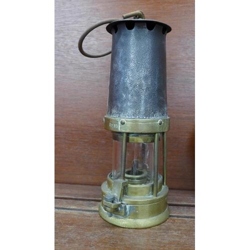 614 - A Davis, Derby, miner's safety lamp...