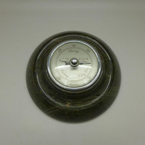 636 - A circa 1950 Cornish serpentine barometer...
