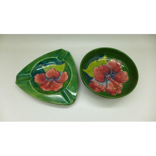 652 - A Moorcroft dish and ashtray, green Hibiscus pattern, impressed marks to the base...