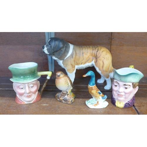 656 - Five items of Beswick;- Saint Bernard, two character jugs, a Robin and a Mallard duck...
