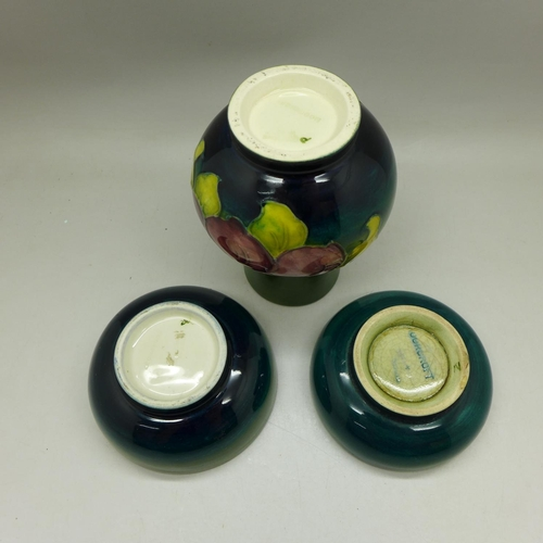 657 - A Moorcroft green vase, 11cm, and two similar green ground dishes...
