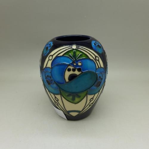 658 - A Moorcroft Rennie Roseblue pattern vase, 9cm...