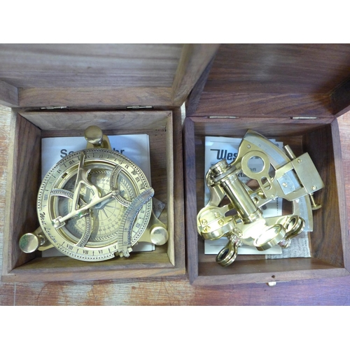 662 - A modern brass sextant and a brass nautical compass, both boxed...