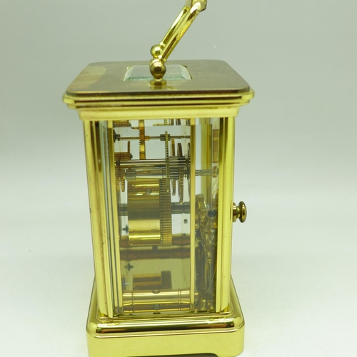 667 - A Matthew Norman carriage clock, boxed, the rear panel bears presentation plaque...