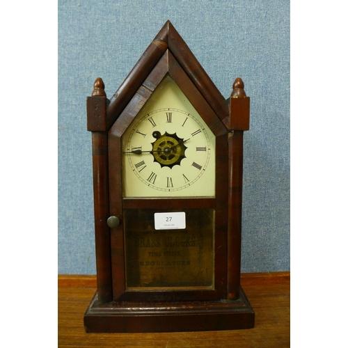 27 - A 19th Century American Waterbury Clock Co. rosewood shelf clock...