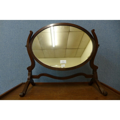 31 - An Edward VII mahogany toilet mirror...