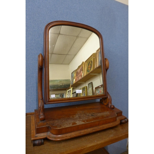32 - A Victorian walnut toilet mirror...