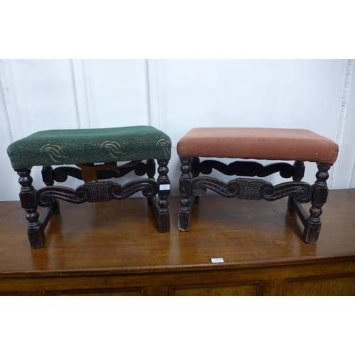 37 - A pair of Victorian carved ebonised foot stools...