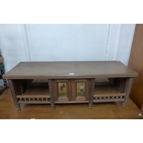 38 - A Victorian Aesthetic Movement desk top cabinet, 41cms h x 119cms w...