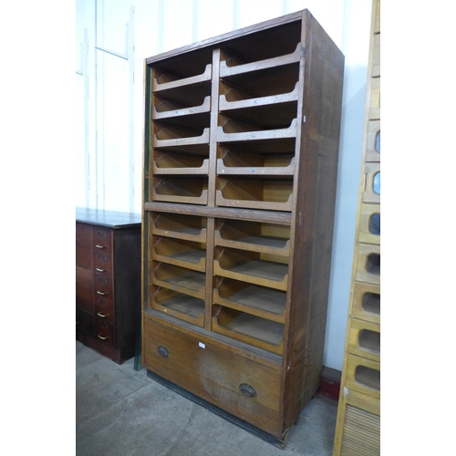 44 - An early 20th Century oak haberdashery shop cabinet, 188cms h, 94cms w, 52cms d...
