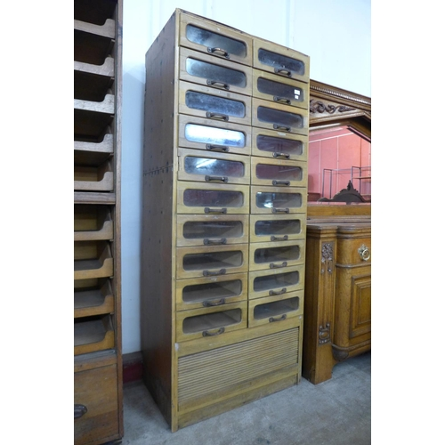 45 - An early 20th Century beech haberdashery shop cabinet, 190cms h, 81cms w, 49cms d...