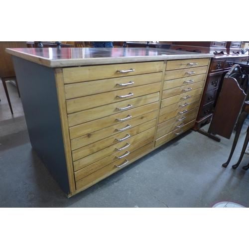 48 - A pitch pine plan chest, 81cms h, 150cms w, 79cms d...