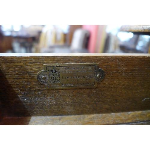 54 - An Edward VII Waring & Gillows burr walnut serving table...