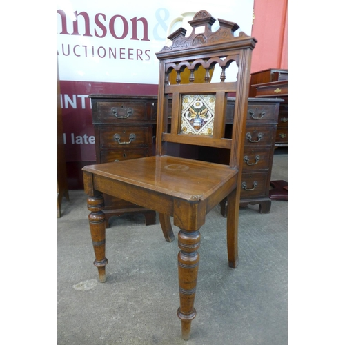 57 - A Victorian Aesthetic Movement mahogany hall chair...