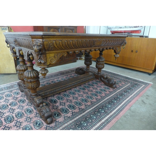 67 - A 19th Century Flemish carved oak two drawer centre table...
