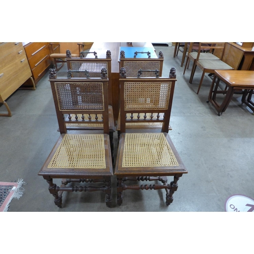 68 - A set of four 19th Century Flemish carved oak bergere dining chairs...