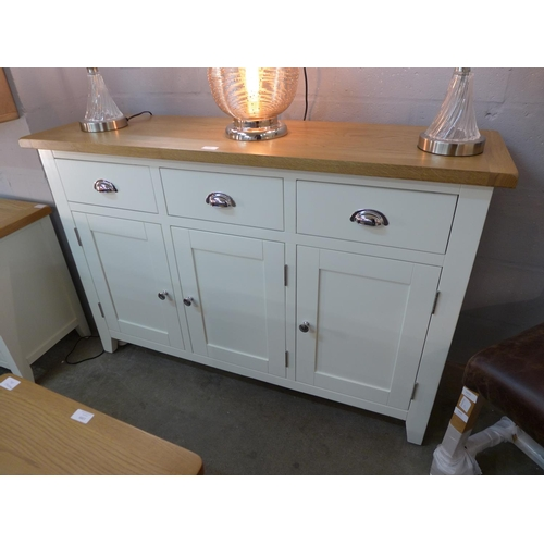 1400 - A Country oak large three door sideboard (WXF05) (Ref 11) * this lot is subject to VAT...
