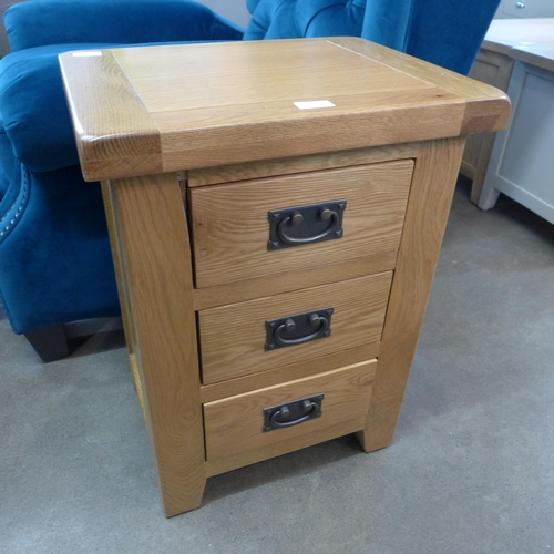 1422 - A Country Oak large 3 drawer bedside (WXF03) (Ref 25)  *This lot is subject to VAT Damage to front...