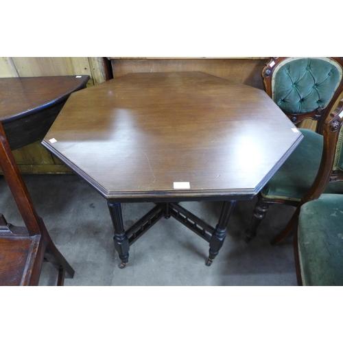 199 - A Victorian mahogany octagonal centre table...
