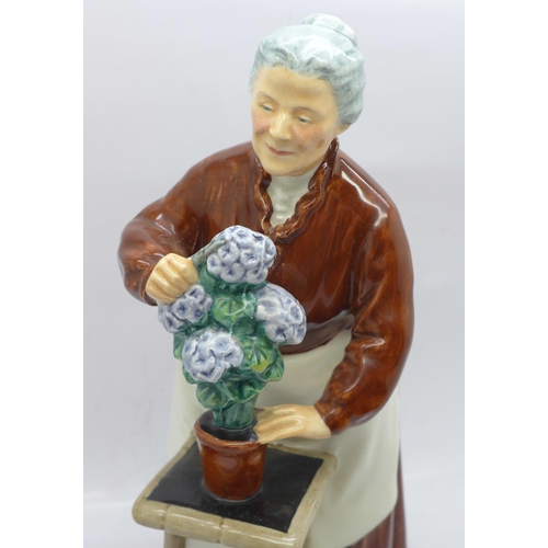 610 - A Royal Doulton figure, Flora...