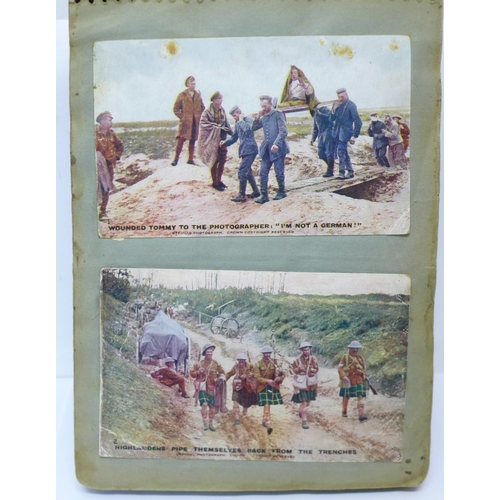 620A - An album of approximately 100 early 20th Century WWI period postcards, mainly WWI related, (stuck in...