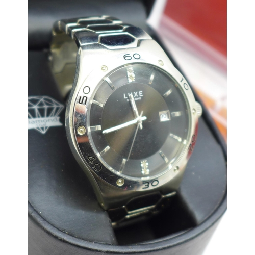 628 - A Luxe diamond dial wristwatch and a Paco Rabanne XS wristwatch...