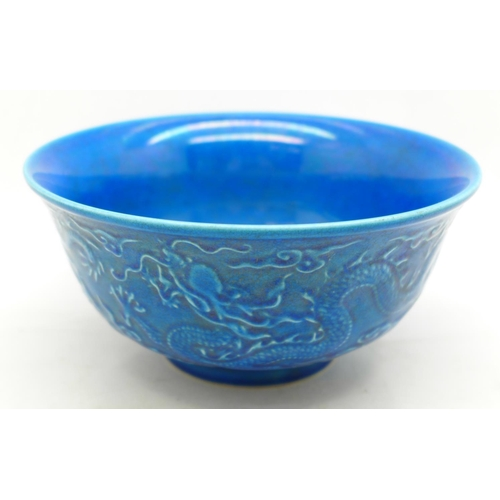 633 - A Chinese porcelain blue glazed dragon bowl, six figure character mark to the base, 16cm in diameter...