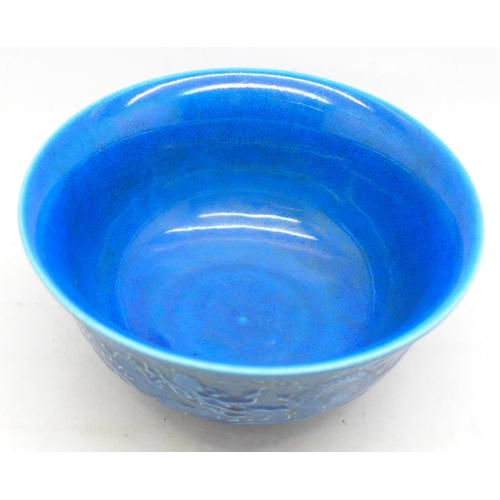 633 - A Chinese porcelain blue glazed dragon bowl, six figure character mark to the base, 16cm in diameter