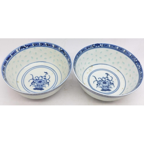 638 - A pair of Chinese famille rose bowls and two Chinese blue and white bowls, all with character marks ...