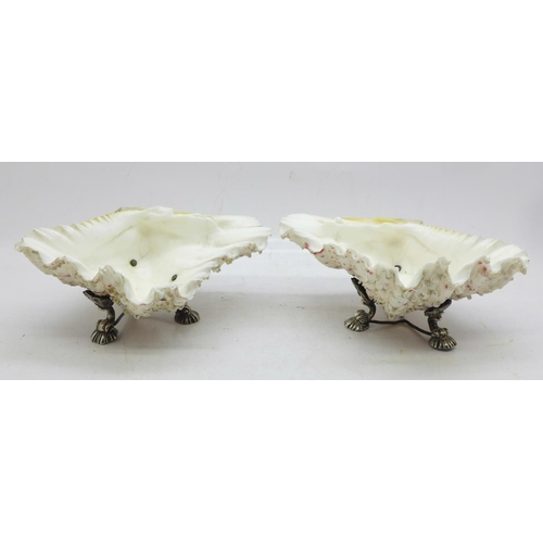 640 - A pair of 19th Century silver plated shell salts, each 14cm wide, one metal base a/f...