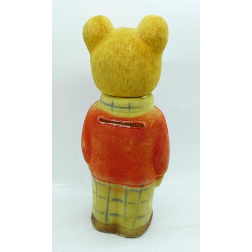 657 - A Rupert The Bear money bank, 11cm...