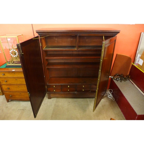 52 - A George III mahogany fitted two door bookcase...