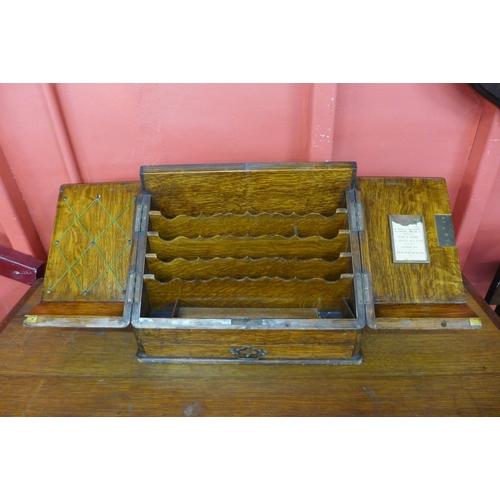 56 - A Victorian oak desk top letter cabinet...