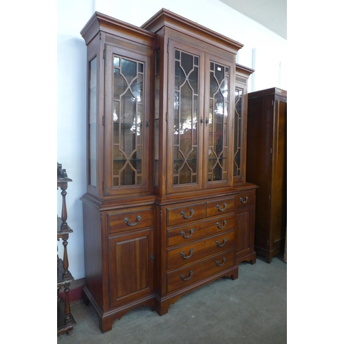 34 - A George III style hardwood breakfront bookcase/display cabinet, 226cms h, 178cms w, 53cms d...