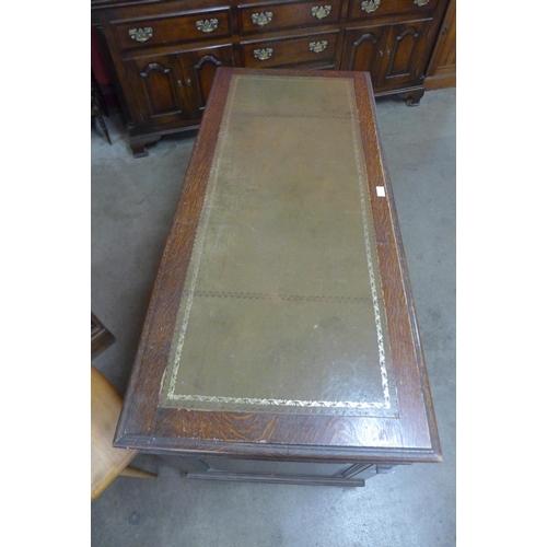 55 - A Victorian oak pedestal desk...