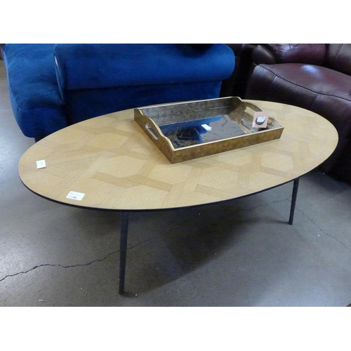 1443 - An oval parquetry and steel coffee table...