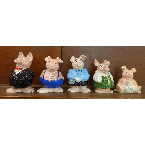 602 - A set of five Wade Nat West pig money banks, (with four original polystyrene boxes and a cardboard b...