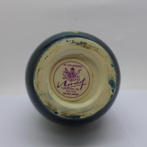 611 - A Moorcroft Hibiscus on green ground vase, 14cm...