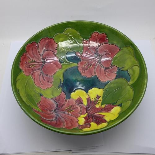 613 - A mid 20th Century Moorcroft Hibiscus on green ground fruit bowl, 26.5cm diameter...